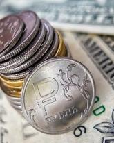 Доллар символически вырос относительно рубля