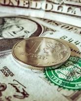 Доллар США вырос на 15 копеек