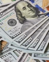Доллар просел на 7 копеек