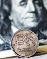 Курс доллара относительно рубля упал на 22 копейки
