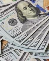 Доллар потерял еще 54 копейки
