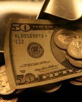 Доллар подорожал на 13,5 копейки