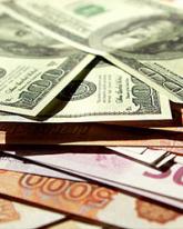 Доллар прибавил 1,5 рубля