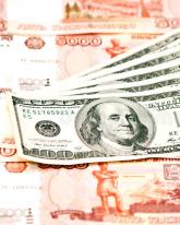 Доллар потерял еще 79 копеек