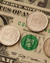Доллар прибавил в понедельник 3 копейки