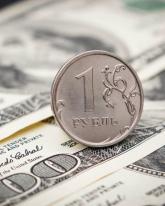 Доллар потерял 18,5 копейки