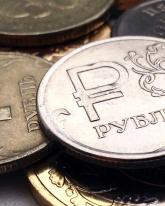 Рубль торгуется в «красной зоне» вслед за нефтью