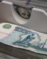 Рубль вырос на 19 копеек