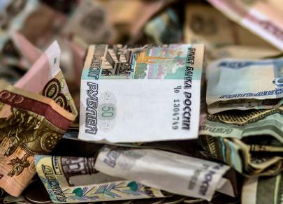 Доллар просел ниже 65 рублей