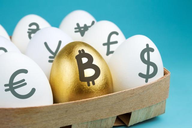 Bloomberg: Биткойн може да достигне границата от 80 000 долара до юни