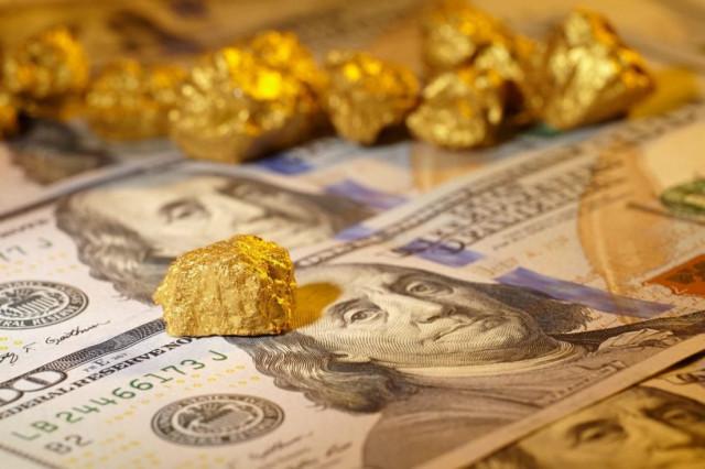 El oro sube, el dólar cae: ecos de la reunión de la Fed de EE.UU.