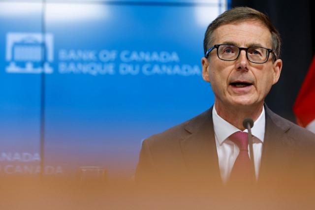 Ngân hàng Canada tăng lãi suất trước khi cắt giảm trái phiếu
